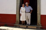 Madre Lourdes and John Doherty standing in the doorway of Buen Pastor