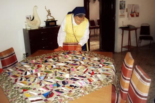 Madre Lourdes admire the quilt