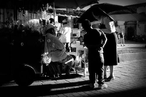 Madre Lourdes buys a boy and his sister some bubbles - San Miguel de Allende, jardin.